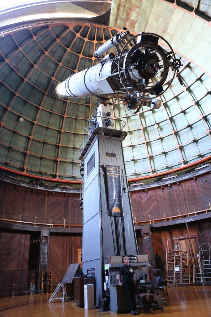standing at base of Lick Observatory 36-inch refractor