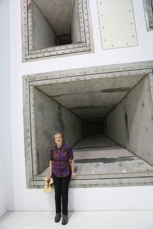 me standing in front of one of the giant woofers in the world's largest/loudest reverb acoustic test chamber at NASA Plum Brook
