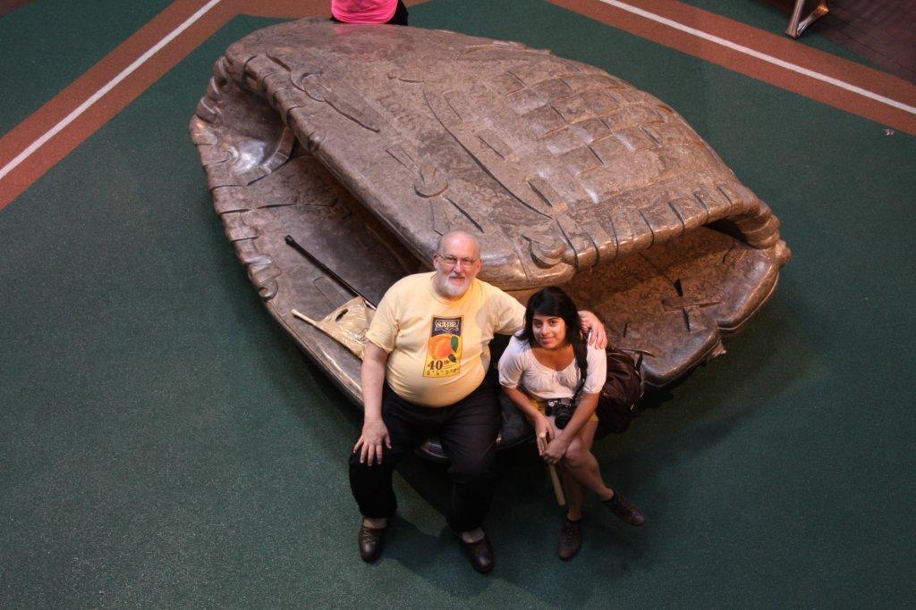 Waff with stepdaughter Roxana Bell sitting in a giant catcher's mitt at the Louisville Slugger factory museum in August 2010.