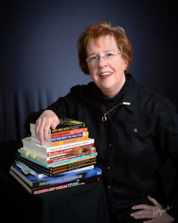 formal author portrait of Trudy E. Bell with books written